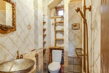 Art bathroom with luxe finishes and rain shower