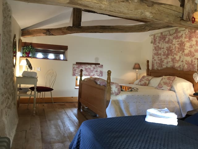 """The """"family bedroom"""". Plenty of space for 4. One king size and two single beds"""