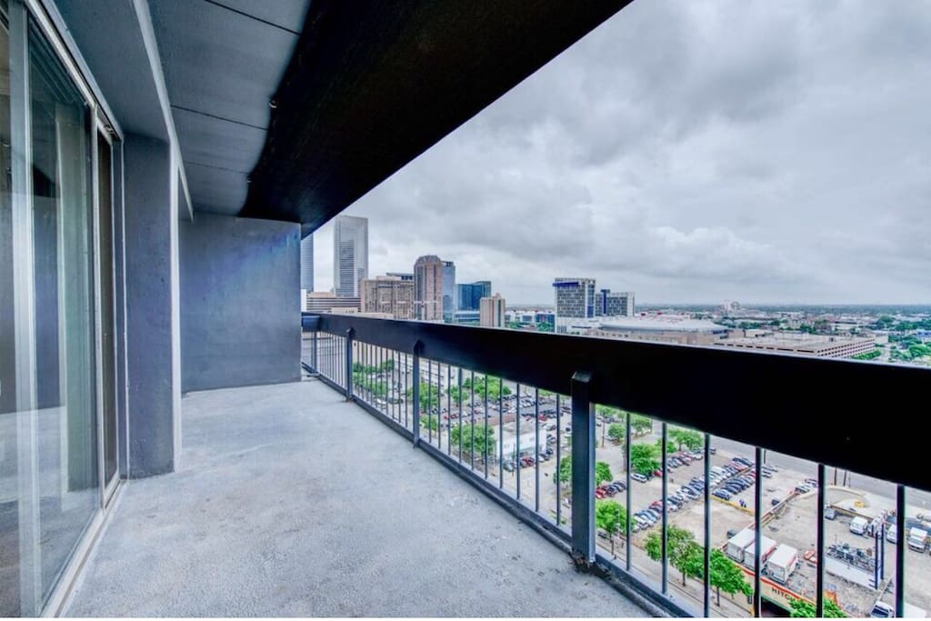 Balcony views of downtown Houston and the Toyota center