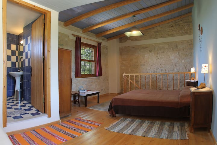 bedroom and bathroom on traditional mezzanine at Agioklima 3bed Guest House