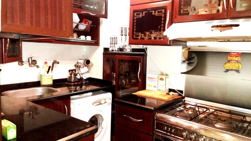 * Kitchen Full Of Equipments  * Modern Style   * Spot Calm Lighting   * Big Air extractor  * Large silver cooker with five burners  And an oven  * Washing Machine with many different programs