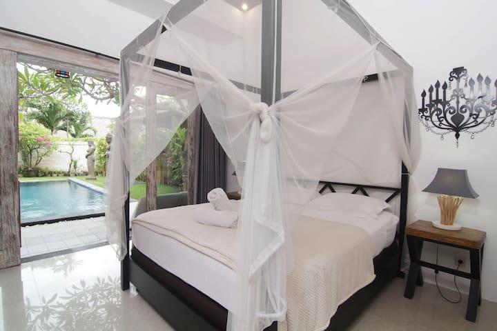 BEDROOM 1 WITH EN SUITE AND POOL