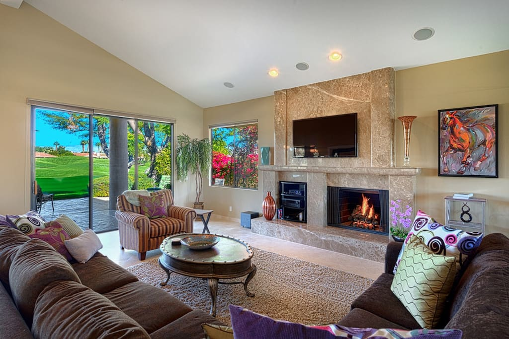 Huge sectional to soak up the fire, watch a movie with surround sound or catch golfers passing by