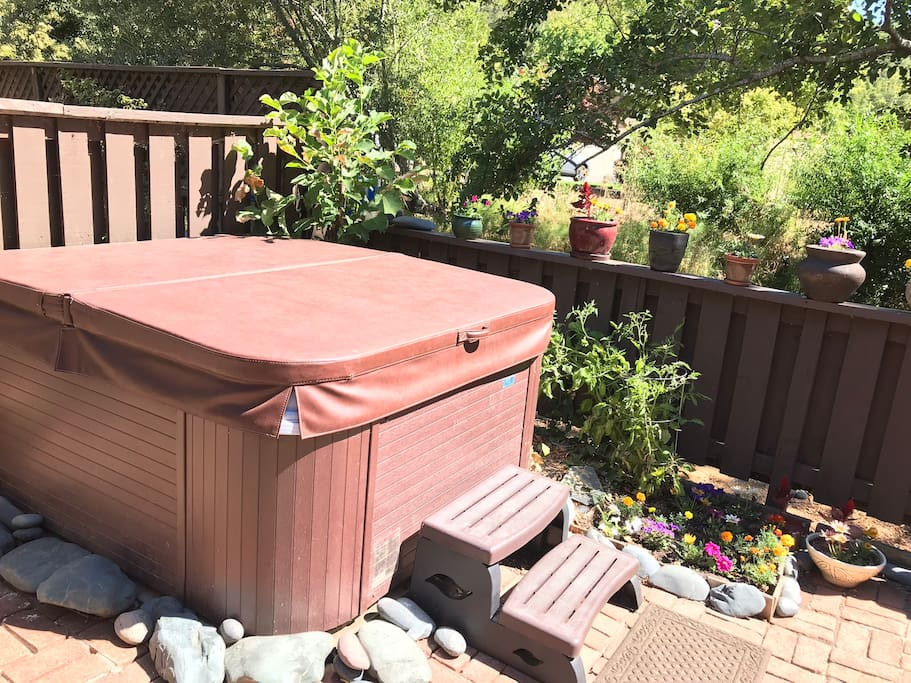 The hot tub you will enjoy in the back patio