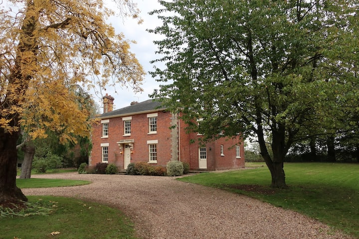 Country house set in rolling suffolk countryside