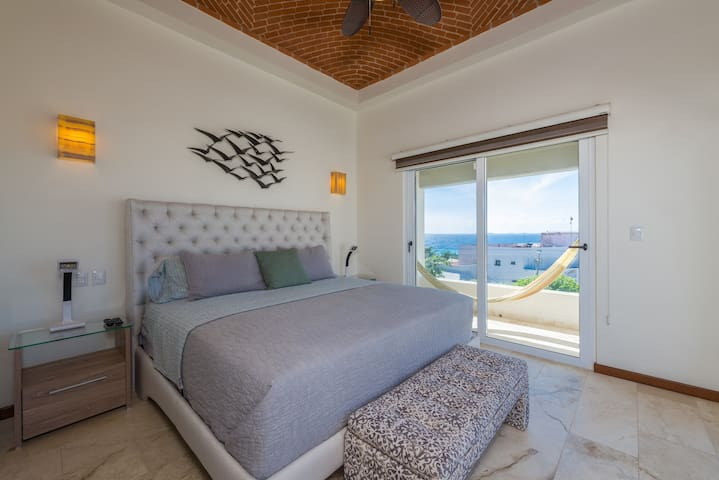 Secondary bedroom + king size bed + A/C + TV + ceiling fan  + ocean view + two balconies + high quality mattress + natural lighting