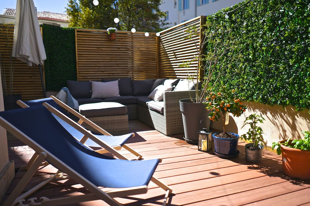 Terrace with large dinner table, bbq, lounge group and sun-chairs