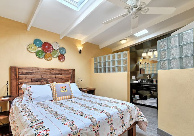 The beautiful skylight bedroom has a queen size memory bed, premium bedding and an ensuite bathroom.    The skylight over the bed has a shade so you can adjust the amount of light that comes in.