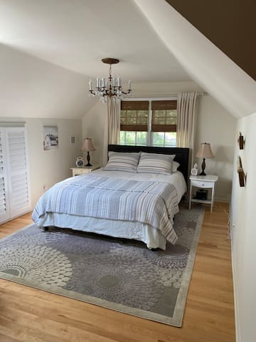 Master bedroom with queen size mattress.