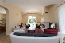 dual aspect Sitting room looking onto pool terrace