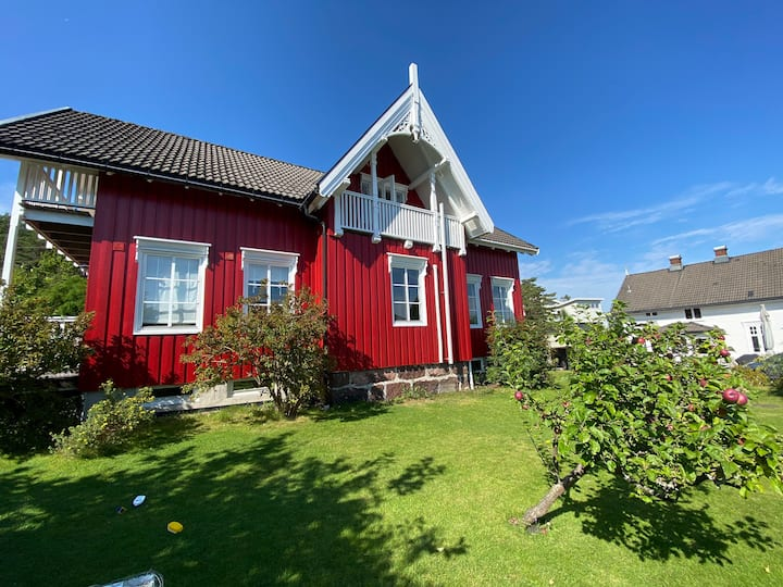 Idyllic wooden house on Husøy Island