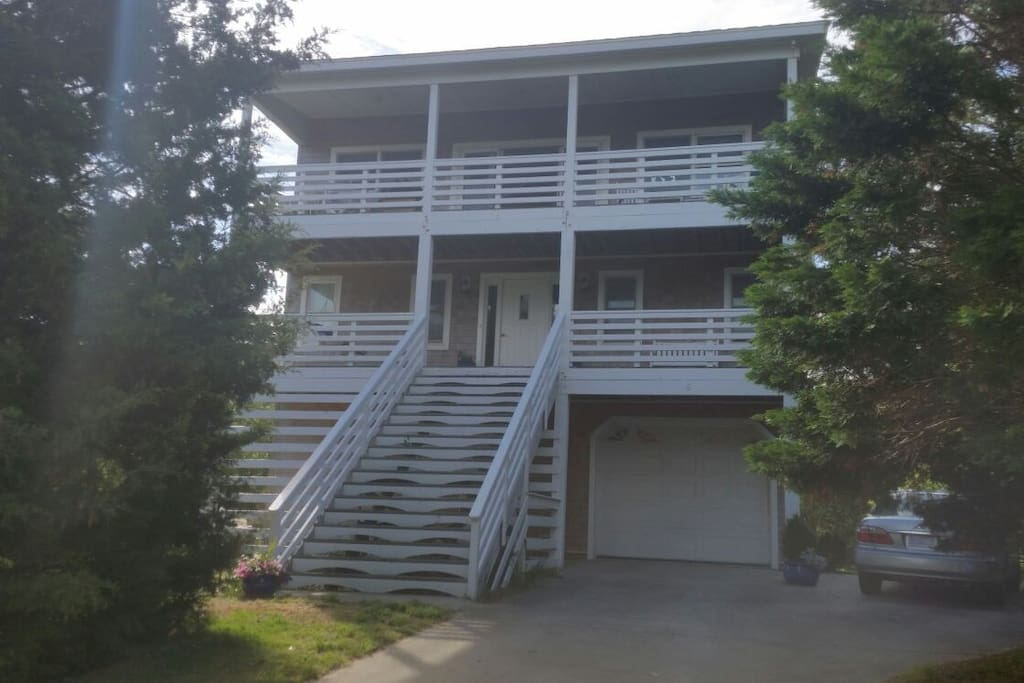 From the outside.. Entire Top level Living/ kitchen/dining area and half middle level with 2 bedrooms and full bathroom