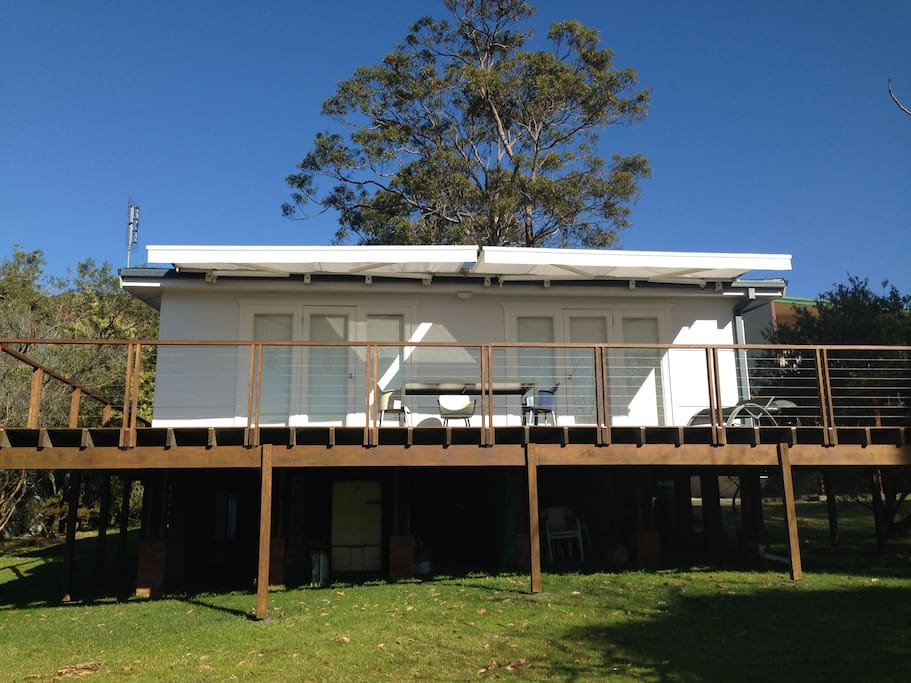 Front view of our beach house that offers an expansive entertaining area on the wraparound baclcony.
