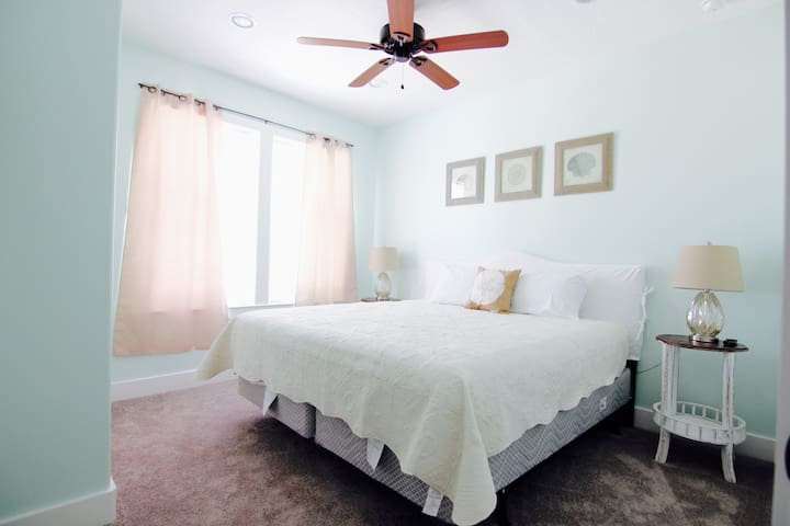 1st bedroom 2nd floor, tv, fan, private bathroom