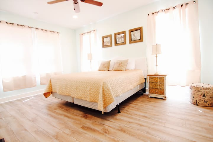 Master Bedroom 1st floor, tv, fan, private bathroom with shower, bath tub and double vanity
