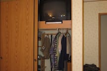 Guest bedroom closet with TV