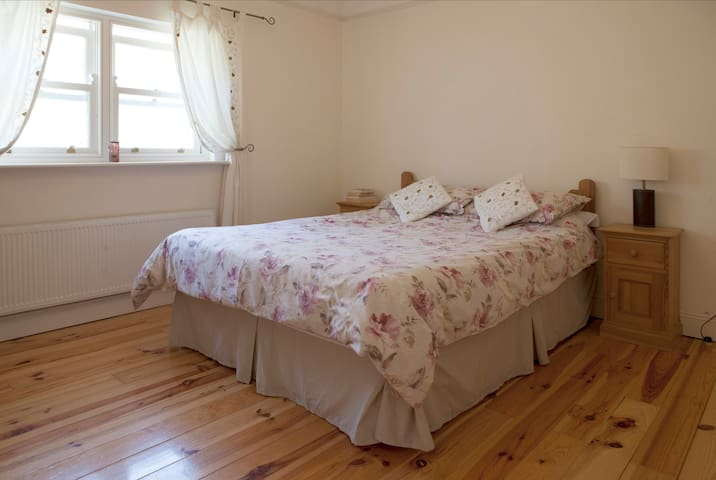 Comfortable king size bed.  Room overlooks the back garden and medieval town wall of Athenry.