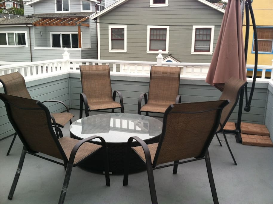 The deck has a fire-pit and outdoor heater.