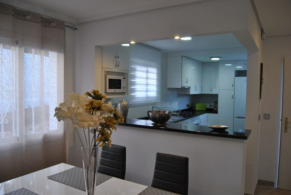 dining area and open plan modern kitchen