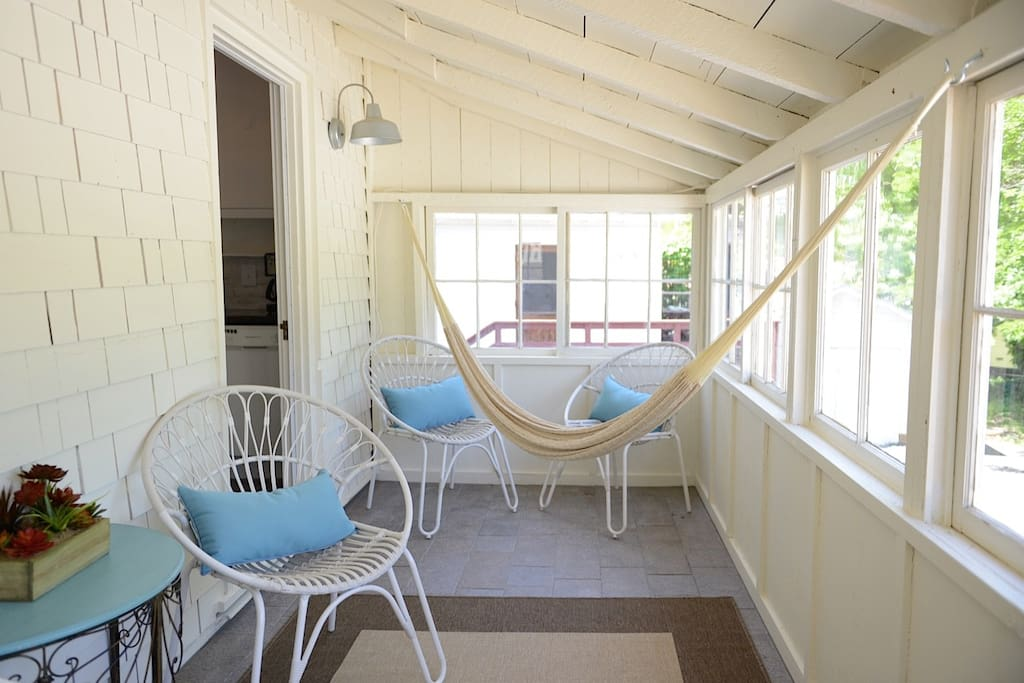 Enjoy the sun in the enclosed porch.