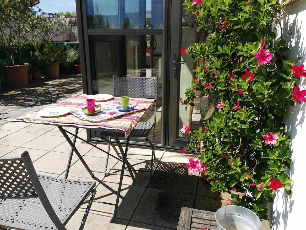 Calm and sunny terrace for nice outdoor meals