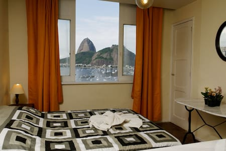 "Our studio will take you from the start with the fantastic view to the Sugar Loaf and Botafogo Bay but also feel a true ""carioca"" neighbourhood - markets, bars, restaurants - even an 8 stories mall on the corner - and transportation for the whole Rio"