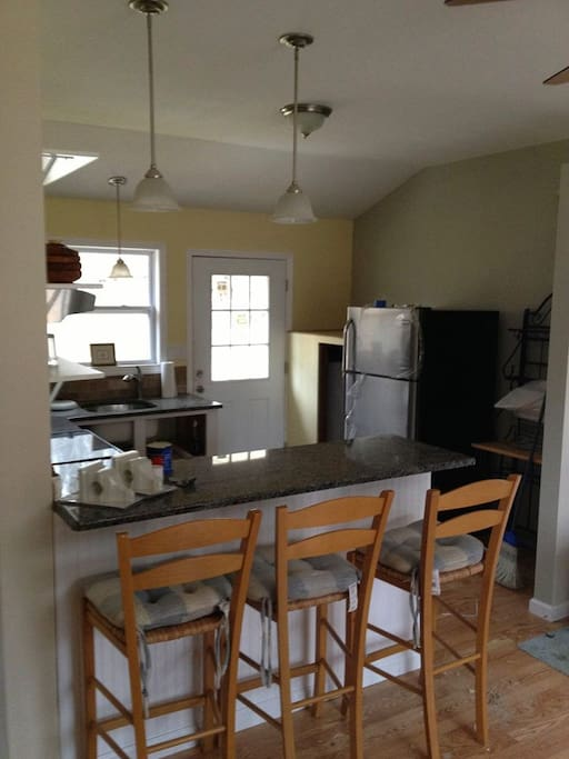 Eat in breakfast bar with granite counter tops.