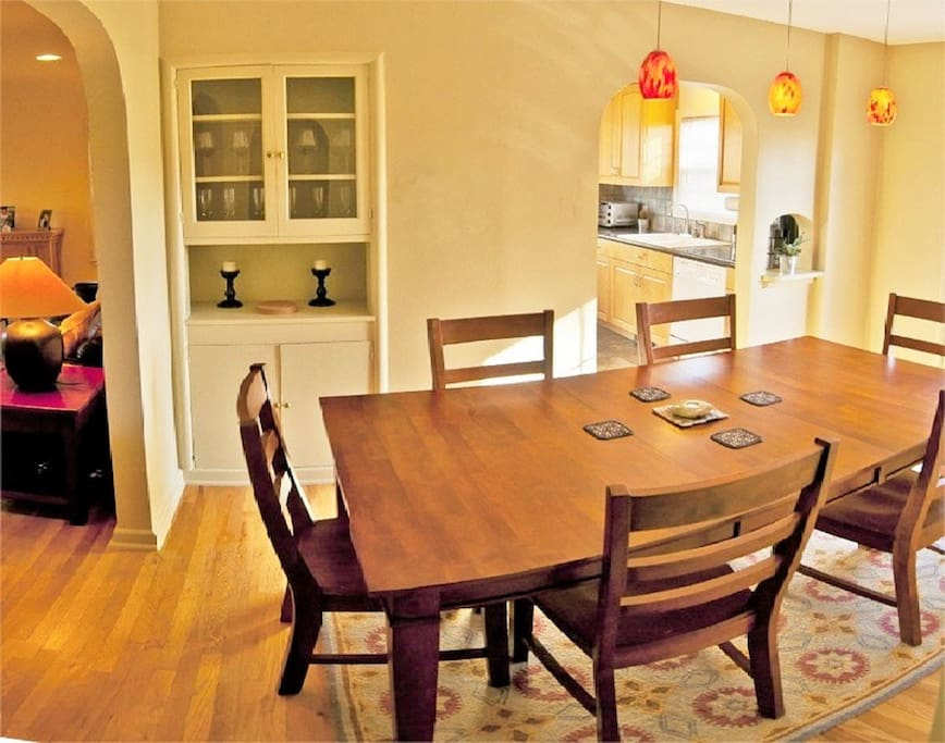 Spacious formal dining room has enough seating for 8 people around the table