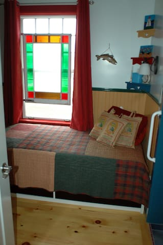 Second bedroom, with twin bed. Looks out over the Annapolis River and town haul-up.