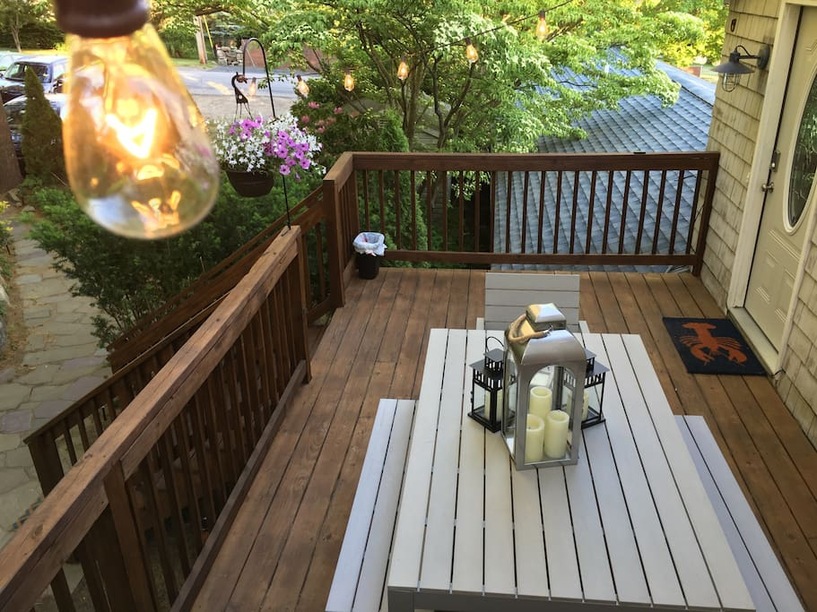The private deck features seating for six.  The edison string lights come on automatically at sundown.  This is a great place to relax and unwind after a day at the beach.