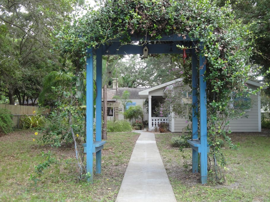 The approach to your guest cottage through the blue arbor