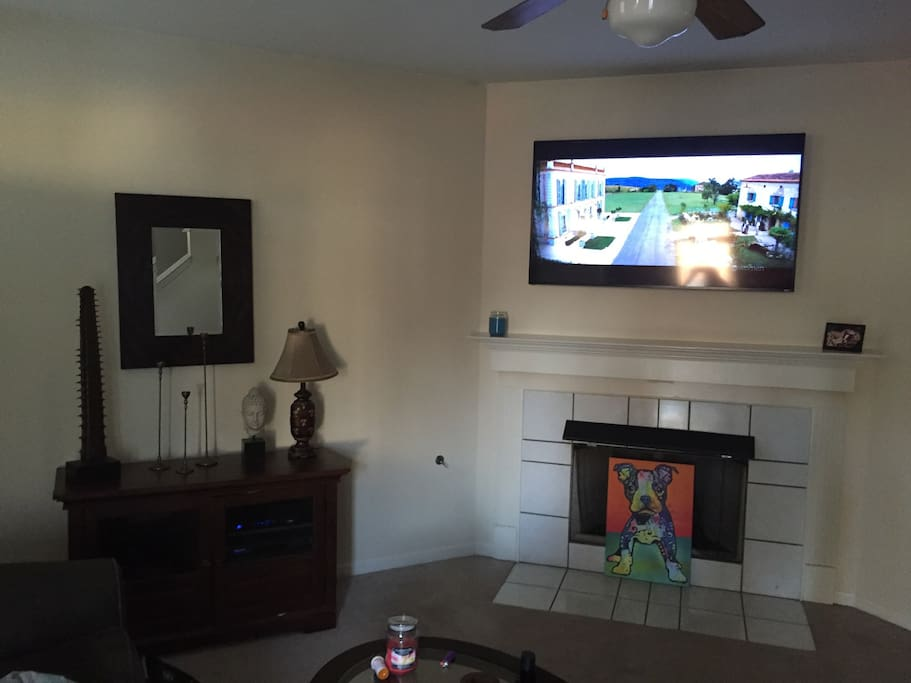 Living room. 60 inch 4D HD TV- Directv all movie channels- smart tv with Netflix and Amazon Prime account for your use!