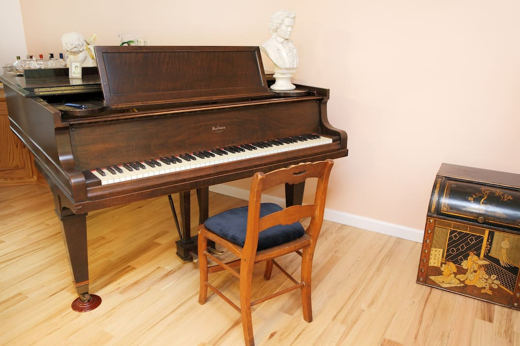 Baldwin parlor grand piano complete with bust of Beethoven. We keep it tuned.