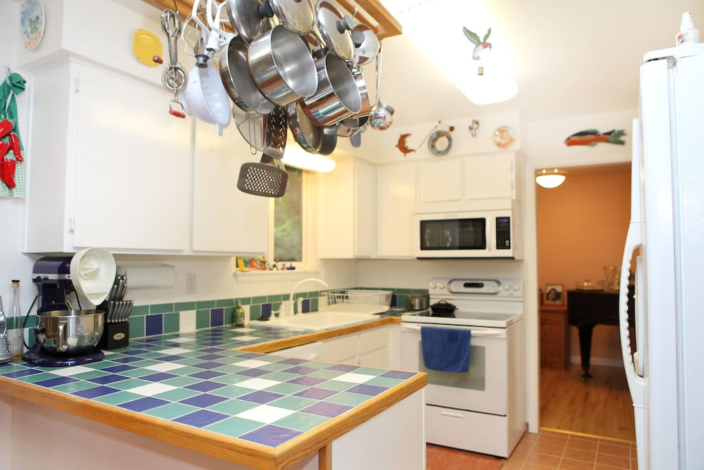 Kitchen with tile counter tops.