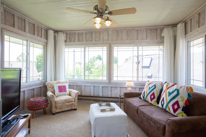 Secluded sleeping porch/den/office.  We have a folding table if you need a second workspace, or close the curtains and pull out the sofa to convert to a private bedroom.