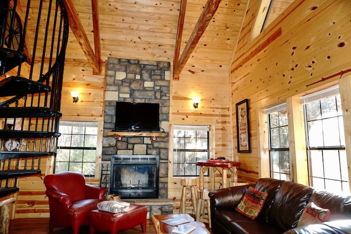 Branson Cabin is fully furnished with Aspen Furniture. Enjoy an evening in front of the wood-burning fireplace. Cabin amenities include a Hot Tub and Foosball Table.