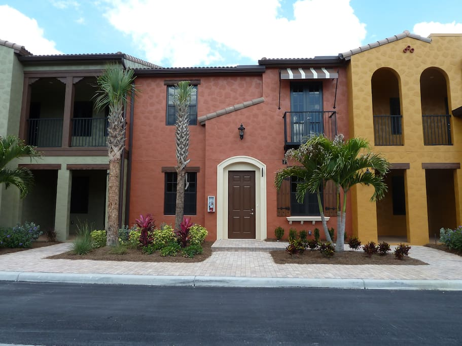 Front of building.  Front door is in center with each private lanai on sides.  One is in the green side and one is in the gold side.  Around back us a 2 car garage.  Street parking is also available.