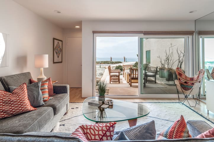 Living room with sit down ocean views and large outdoor patio.