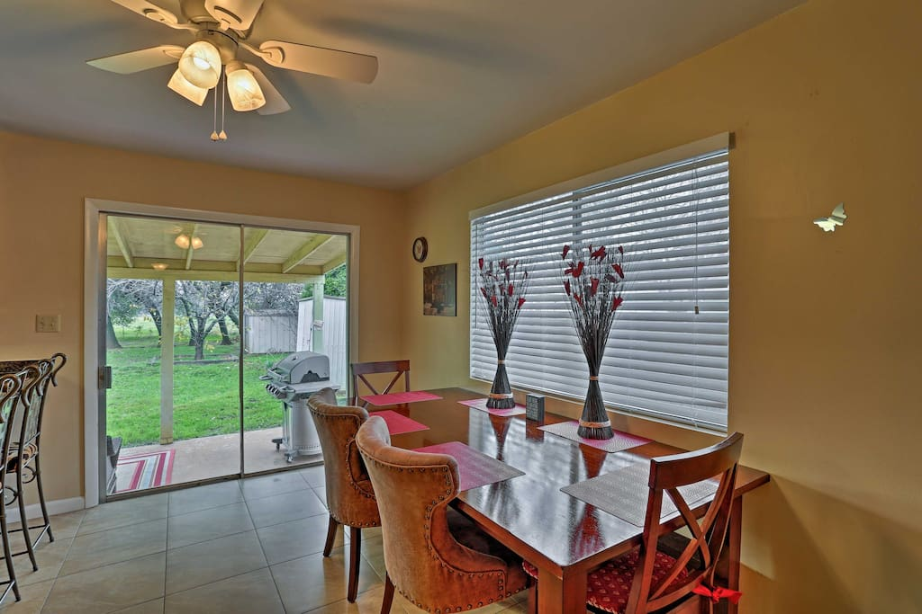 This spacious 1,066-square-foot home offers 9 lucky guests a wood-burning fireplace, furnished back patio, and a fenced-in yard!