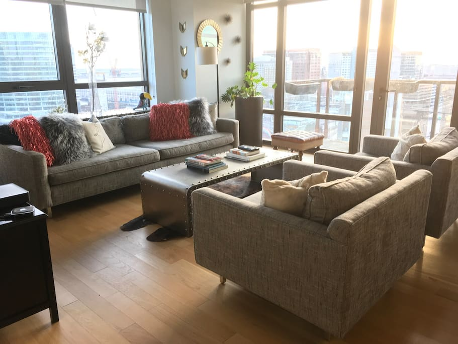 Living room with private balcony overlooking Boston and the Seaport / convention center area.