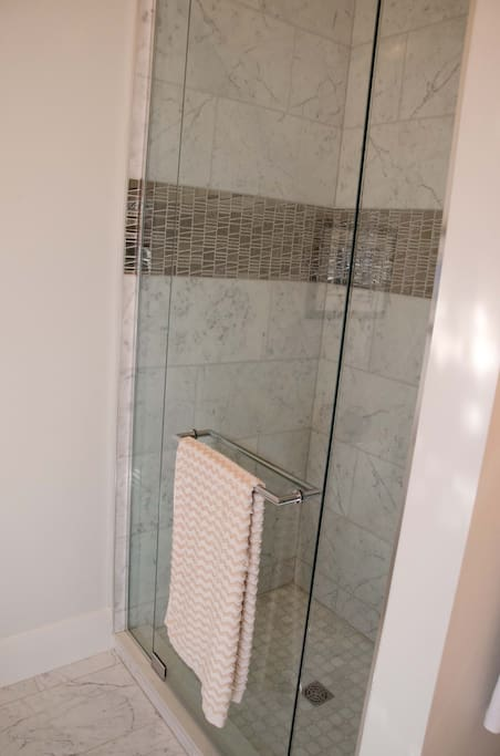 Private marble ensuite shower.