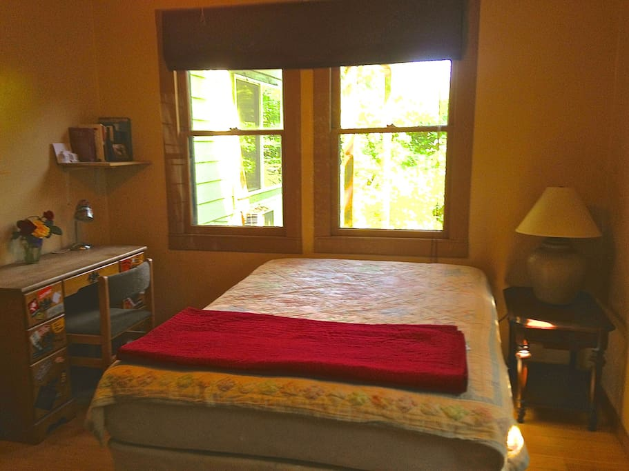 The guest room has a double bed, desk, bureau, closet, end table, lamps, an air conditioner & heater,  and a quiet, efficient, ceiling fan.