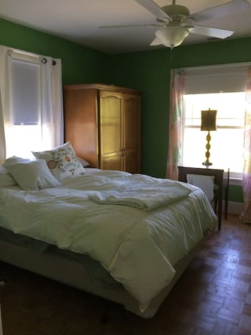 Let the sunshine in or use the room darkening shades. This room has a queen size bed and is extra comfy.
