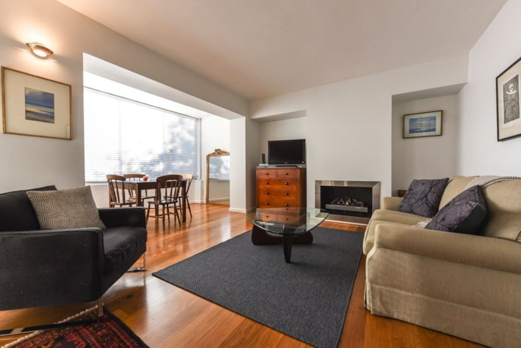 Lovely, light, bright open plan living area with electric fireplace.