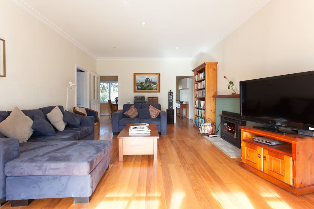 Living room with aircon, heating, open fire