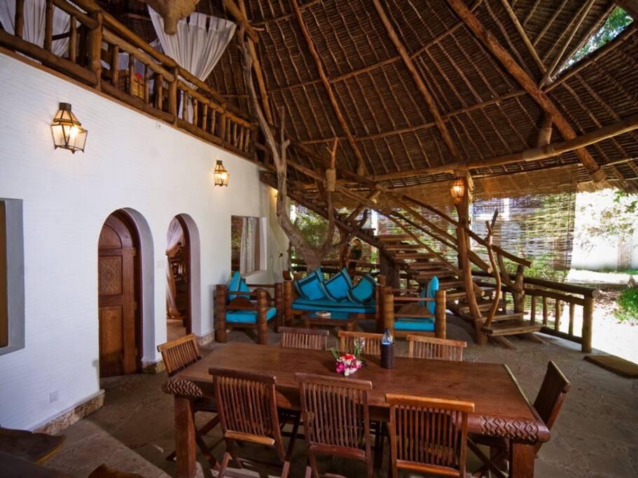 the living room and veranda in the villa