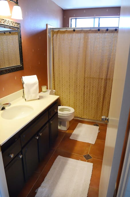 Bathroom and shower are steps away from bedroom.