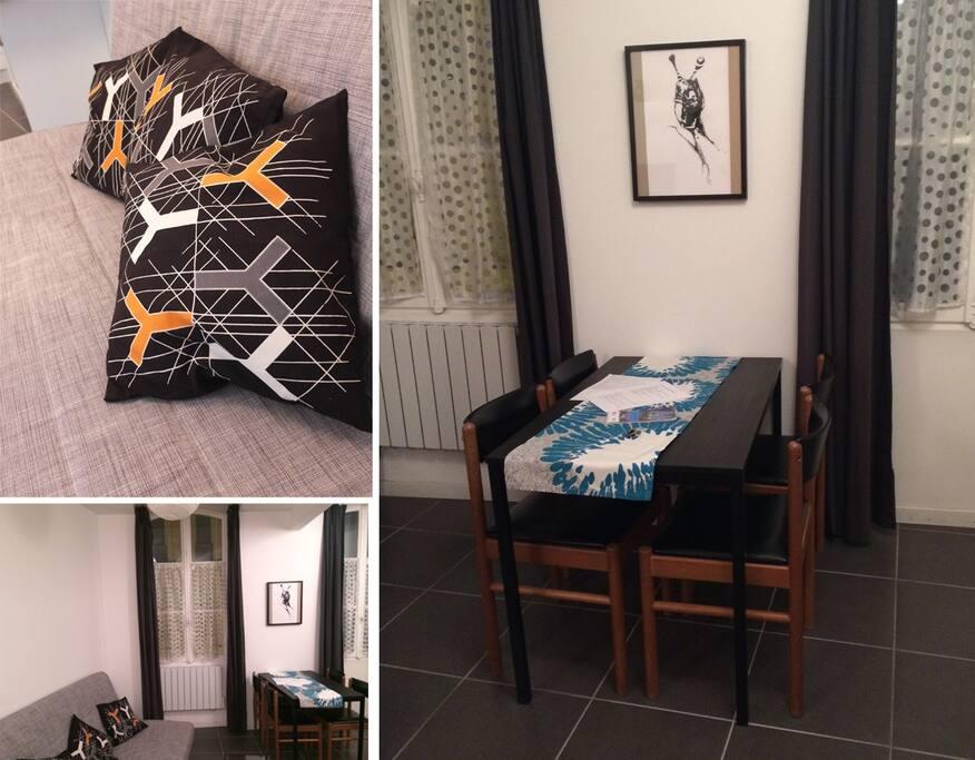 Salon avec canapé lit + table avec 4 chaises + TV.
