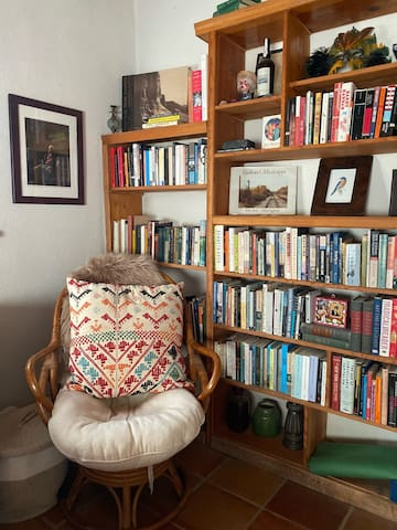 Bedroom 2 has a wall of books, desk, and two twin beds that can be combined into a King bed or separated