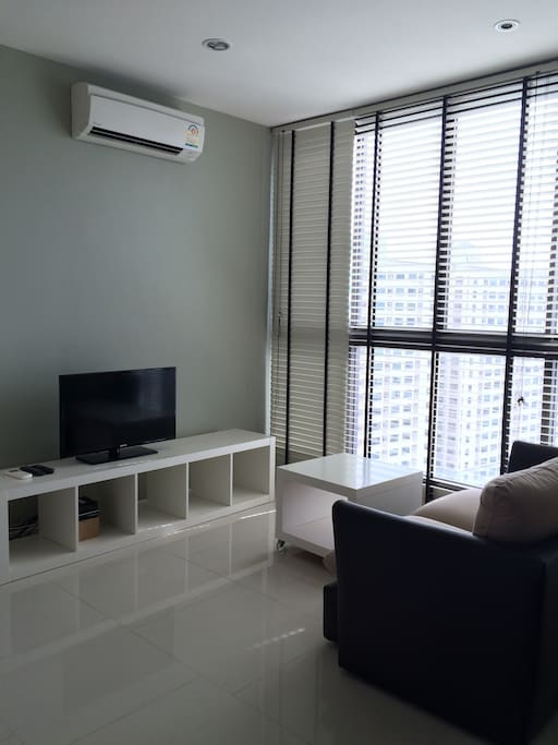 Living area with the wide and tall windows to see sky view